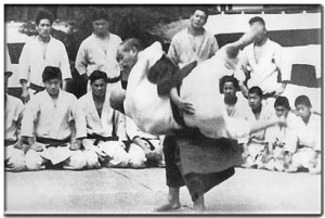 Dr. Kano demonstrating a judo throw.