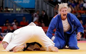 Kayla Harrison of the U.S. reacts after defeating Brazil's Mayra Aguiar in women's -78kg semi-final judo match at London 2012 Olympic Games